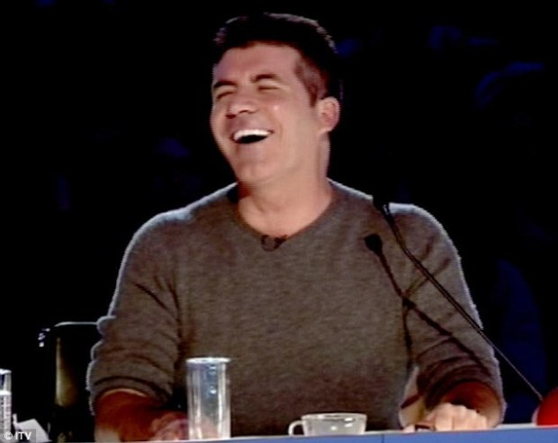 simon cowell laughting at dog pausy on britans got talent