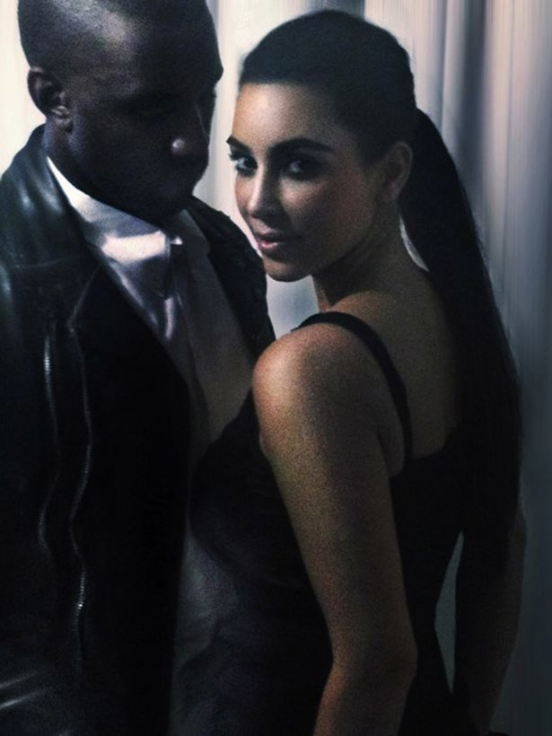 Kim+Kardashian+and+Kanye+West+backstage+at+his+Watch+The+Throne+tour