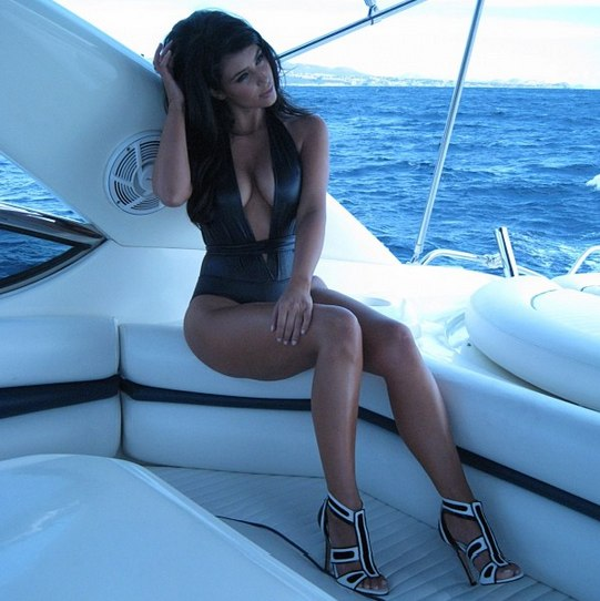 Kim Kardashian Looks Amazing In A Swimsuit In MIA!