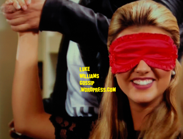 Marion Falcone putting blindfold on Lucy towie