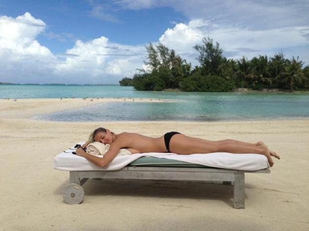 Heidi Klum Sunbathes Topless On Holiday